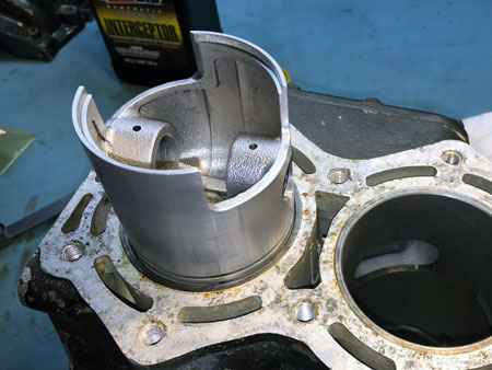 Setting piston ring into bore for end gapping